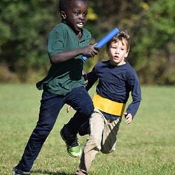 Foundation School Relay Racers - Two boys baton