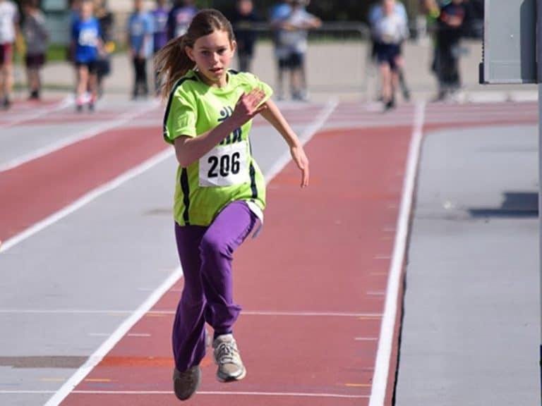 Foundation Athelete - Girl running on race track
