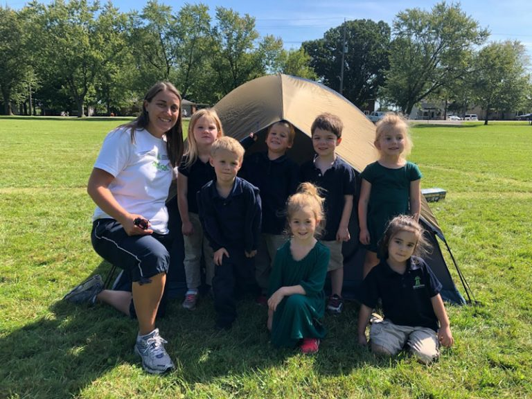 Foundation Teacher with students at a tent