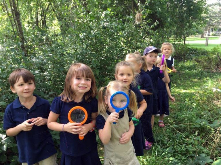 Foundation Class on Science Walk with magnifying glass