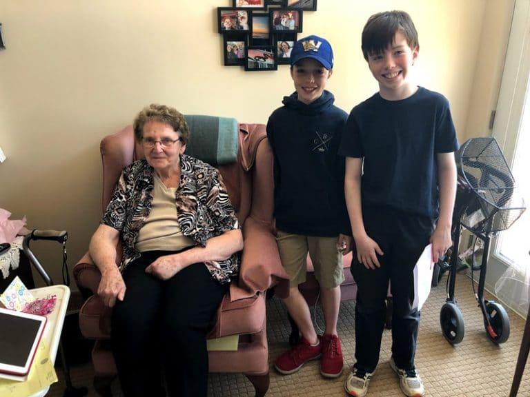 Foundation Boys with Elderly Woman in Nursing Home