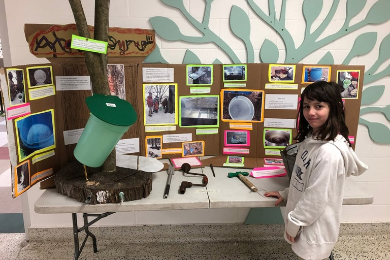 Girl with Maple Syrup Display at Foundation Christian School