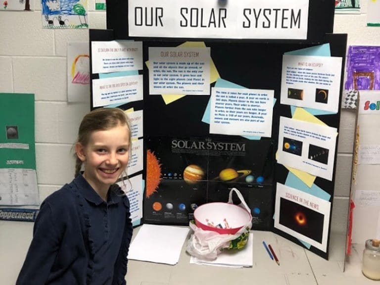 Foundation School Science Fair - Girl with Solar System Display