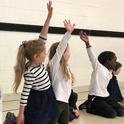 Foundation Christian School Students Raising their Hands
